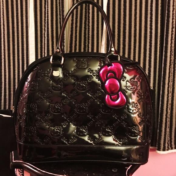 fd19682396 Hello Kitty x Loungefly Patent purse. Loungefly.  M 5ba6dce9df03070b4d81a3a6. M 5ba6dceda31c33dea03e1794
